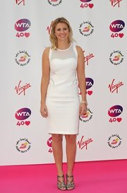 Holly Branson looked impeccably styled at the pre-Wimbledon party in a modern sheer-panel white sheath.