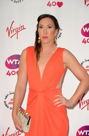 Jelena Jankovic was in the mood for brights at the pre-Wimbledon party, pairing her coral dress with a chainmail clutch featuring colorful accents.
