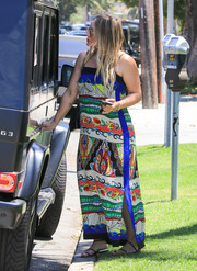 Hilary Duff cut a colorful figure in a printed maxi maternity dress while out and about in LA.