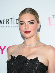 Kate Upton accentuated her kissers with bold berry lipstick.
