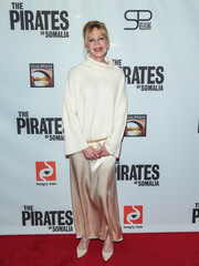 Melanie Griffith paired her sweater with a gold satin maxi skirt for a red carpet-worthy finish.