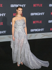 Lucy Fry looked enchanting in a strapless silver fishtail gown by Toni Maticevski at the premiere of 'Bright.'