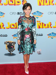 Isabela Moner completed her red carpet look with basic white pumps.