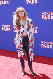 Underneath her coat, Connie Britton kept it casual in jeans and a shirt.