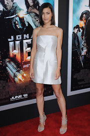 Julia wore a structured metallic mini dress with stone strappy suede sandals.