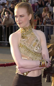 Nicole Kidman paired her embellished halter top with matching golden bangle bracelets.