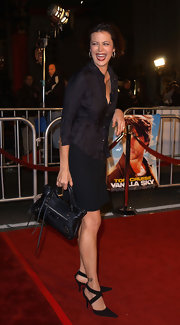 Catherine Bell looked casual yet smart in a black fitted blouse and mini skirt.