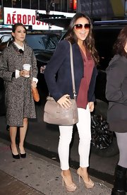 Shay Mitchell lightened her fall colors with white skinny jeans.