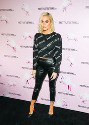 Khloe Kardashian teamed her top with a pair of black faux-leather capris, also by PrettyLittleThing.