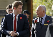 Prince Harry wore a classic red narrow tie for the England vs. New Zealand rugby match.