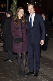 Kate Middleton looked stylishly ready for New York weather in a purple Seraphine tweed coat.