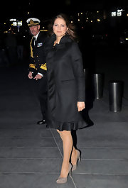 Princess Madeleine put a girly spin to the classic wool coat by opting for one with subtle ruffles at the hem and neckline.