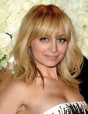 Nicole Richie wore her layered wavy cut casually tousled with long wispy bangs at the QVC Red Carpet Style event.