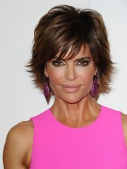 Lisa Rinna accented her bold pink ensemble with a hint of pale beige-pink lipstick. The lip look paired perfectly with her smoky eyes.