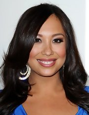 Cheryl Burke attended the QVC Red Carpet Style event wearing a sheer mauve lipstick.