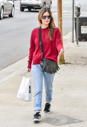 Rachel Bilson kept cozy in a red crewneck sweater while running errands.