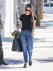 Rachel Bilson accessorized with a black leather tote by Alexander Wang.