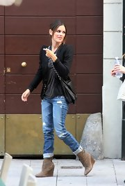 Rachel Bilson paired her bold blazer with a suede pair of ankle boots.