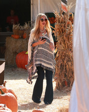 Rachel Zoe kept cozy in a patterned poncho while visiting Mr. Bones Pumpkin Patch.
