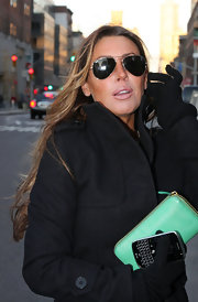 Rachel Uchitel loves her Ray-ban aviator glasses.