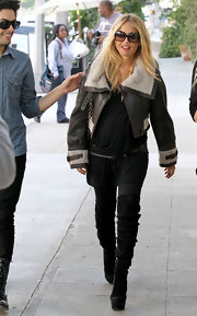 Rachel Zoe showed off her fantastic maternity style in slouchy black suede over-the-knee boots with tall platforms.