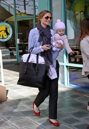 A smiley Rebecca Gayheart carried a large black leather tote.