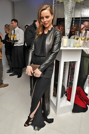 Melissa George toughened her sheer black gown with a sleek black leather jacket.