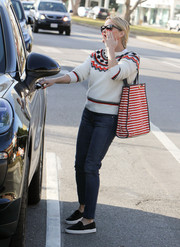 Reese Witherspoon added an extra festive touch with a red and white striped bag by Draper James.