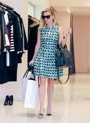 Reese Witherspoon charmed in a fit-and-flare print dress by Tanya Taylor while out shopping.