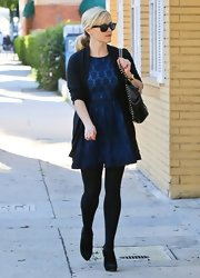 Reese looked so cute in her blue eyelet cocktail dress while out in Beverly Hills.