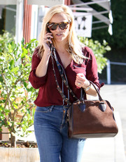 Reese Witherspoon geared up for a sunny day in LA with a pair of tortoiseshell wayfarers.