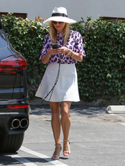 Reese Witherspoon's lavender Draper James floral blouse and white mini skirt were a lovely pairing!
