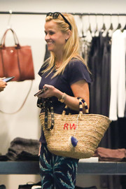 Reese Witherspoon channeled summer with this personalized straw tote by Draper James while out and about.