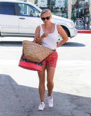 Reese Witherspoon looked youthful in printed shorts by Draper James teamed with a white tank top while out in Los Angeles.