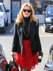 Reese Witherspoon went for retro styling with a pair of cateye sunnies.
