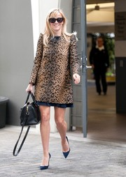 Reese Witherspoon cut a stylish figure on the streets of Beverly Hills in a leopard-patterned jacquard coat by RED Valentino.