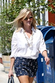 Reese Witherspoon showed off her summer street style with this white button-down and print shorts combo while out and about in LA.