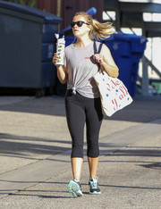Reese Witherspoon teamed a gray muscle tank with capri leggings for her workout look.
