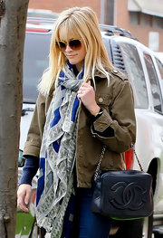 Reese Witherspoon balanced a feminine scarf and purse with an olive military-style cargo coat.