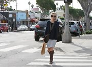 Reese Witherspoon was out and about in a cozy blue sweater paired with dark brown leather knee-high boots.