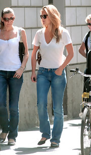 Bar Refaeli went shopping in Milan wearing a classic white v-neck tee with blue jeans and flats.