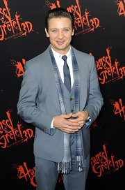 Jeremy Renner looked especially dapper in a blue and silver patterned scarf.
