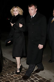 Madonna wore a black wool coat with a fur collar while out with Guy Ritchie in NYC.