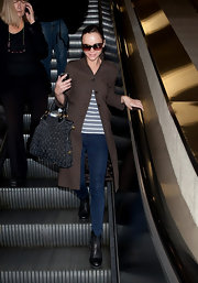 Christina Ricci traveled in style at LAX in skinny jeans paired with black leather boots.