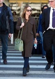 Christina Ricci looked demure yet classy in this single-breasted brown coat and sage shoulder bag.