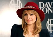 Nicole Richie added the faintest application of peachy-nude lipstick while promoting her House of Harlow fashion collection.