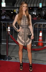 Lydia wore a nude dress with black lace patterned detailing for the premiere of 'Riddick.'