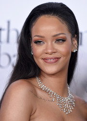 Rihanna accessorized with a stunning diamond chandelier necklace by Cartier.
