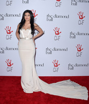 Kylie Jenner was a stunner at the Diamond Ball in a cream-colored August Getty Atelier gown with a super-long train.