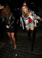 Cara Delevingne was spotted at the Box wearing over-the-knee leather boots.